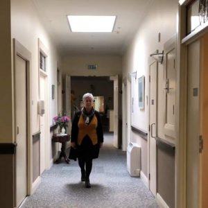 woman walking in a hallway