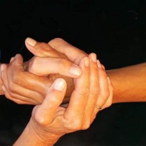close up of two women's intertwined hands